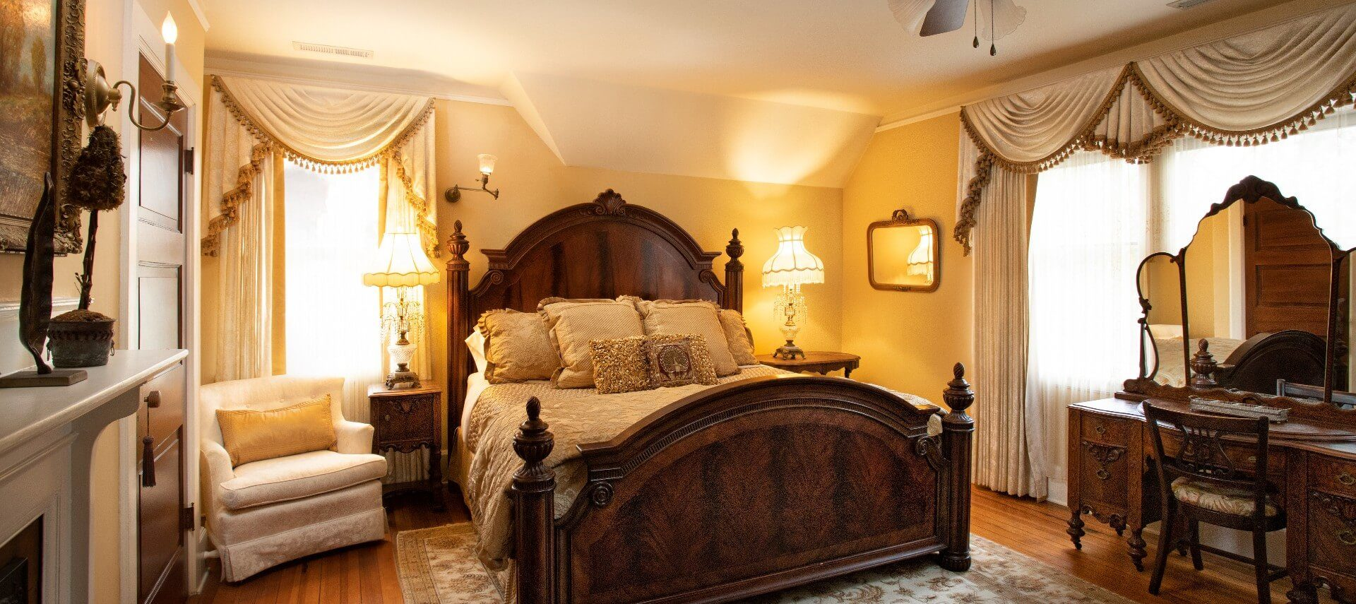 A spacious bedroom in shades of ivory and gold with a plush, king-size bed