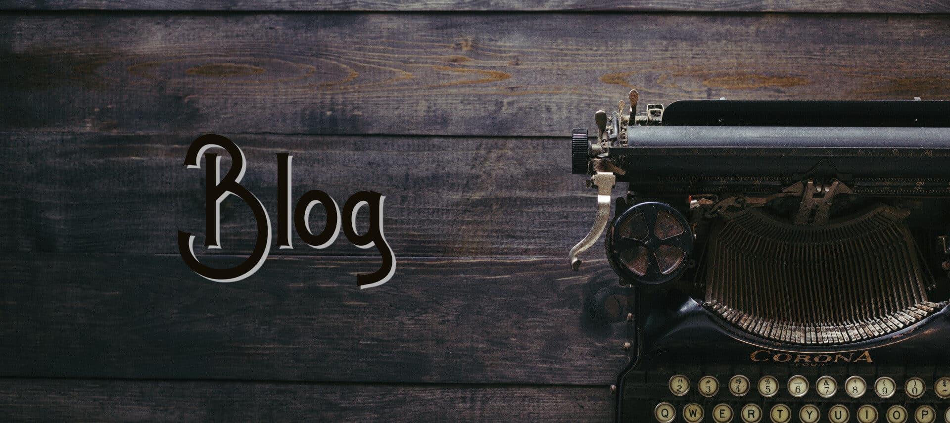 A black antique typewriter sitting on weathered wood planks